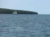 a nice sailboat in the distance